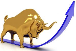 Gold bull illustrating gold set for a new bull run, with blue arrow pointing upwards