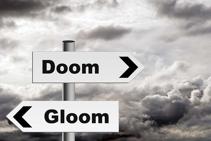 Doom and gloom signs against a stormy background