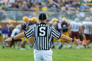 Referee on football field making a call