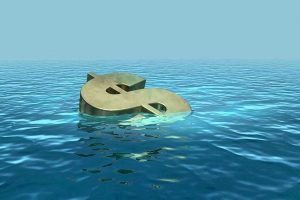 Gold dollar sign sinking in ocean of water