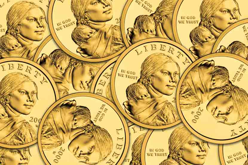 Dozens of Sacajawea gold dollar coins, face up