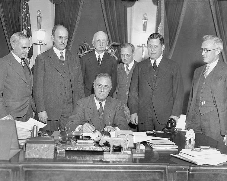 FDR signs gold bill, executive order 6102, forbidding the hoarding of gold coins, gold bullion, and gold certificates with the US