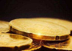 Gold coins reflecting light