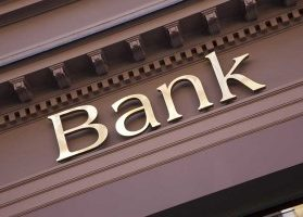 Gold lettering on the front of a brown bank