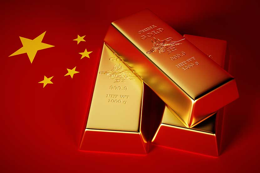 Three 1000 gram gold bars and Chinese flag
