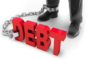 Debt chained to the ankle of business professional