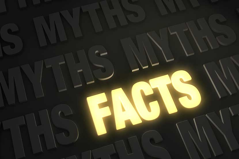 The word FACTS illuminated against dark word MYTHS