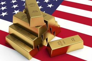 1000 gram gold bars on American flag