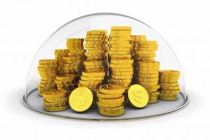Gold coins stacked inside glass bubble indicating protection or insurance