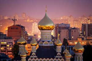 Gold spires of Ukraine at sunset