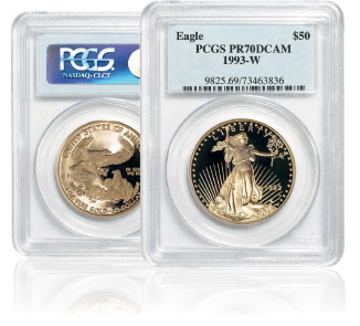 Two Gold American Eagle proof coins standing next to eachother in their PCGS holders with the left one showing the reverse side and the rightr one showing the obverse side