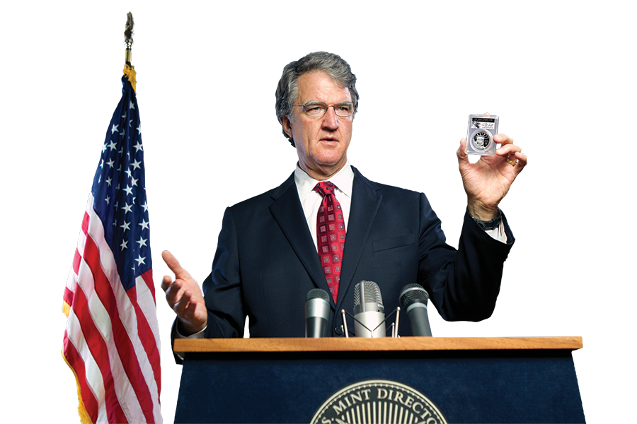 Philip N. Diehl, former Director of the U.S. Mint, talking at a podium and holding a silver coin