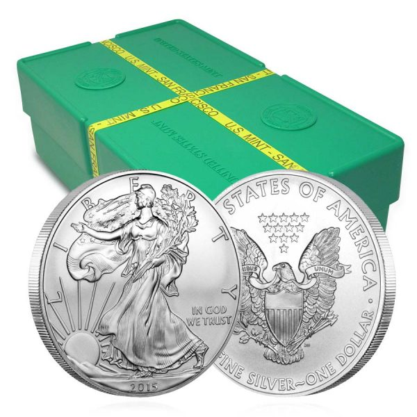 front and back of silver american eagle coin in front of green hox with yellow tape
