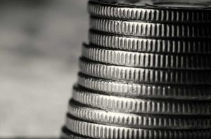 Magnified black and white view of the edge of a stack of platinum coins