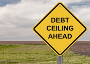 Yellow road sign warning that a debt ceiling is ahead