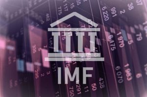 International Monetary Fund logo against purple backdrop of cascading stock market prices