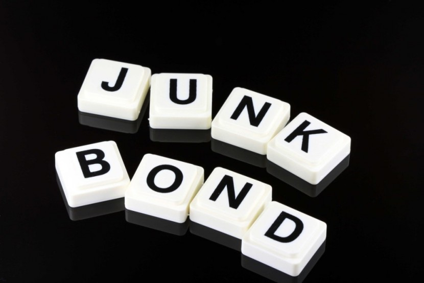 "Individual white blocks with black letters spelling ""Junk Bond"" on black background"