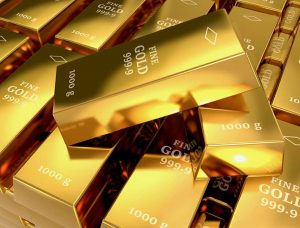 Multiple stacks of 1000 gram fine gold bars