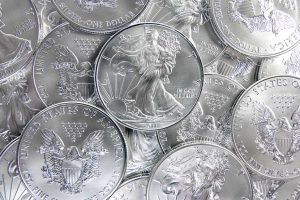 Pile of shiny 1 oz pure silver eagle coins