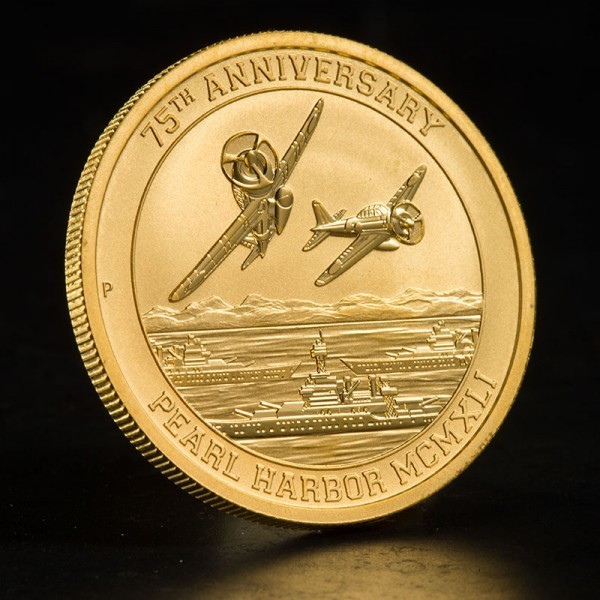 Angled view of U.S. Money Reserve's 1 oz. Pearl Harbor Gold Coin showcasing Japanese fighter planes and U.S. Navy ships on front of coin