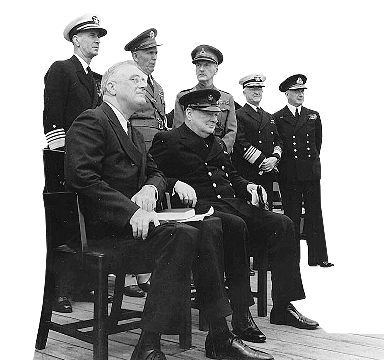President Franklin D. Roosevelt sitting with Prime Minister Winston Churchill and various military officials