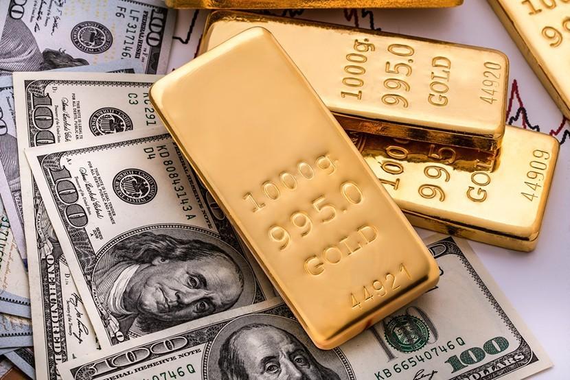 Crisp $100 bills and pure 1000 gram gold bars