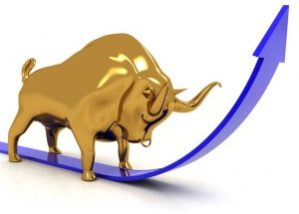Gold bull with head down, with blue arrow indicating gold prices increasing