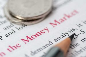 Money market text with quarters and pencil pointing to demand analysis