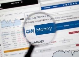 Magnifying glass hovering over CNN Money website