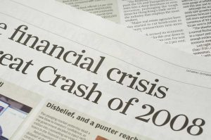 Close-up of newspaper headlines concerning the financial crash of 2008