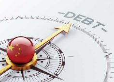 Gold arrow and compass pointing towards debt, illustrating China's debt load reaching a record high