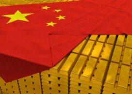 Chinese flag draped across stacks of gold bars