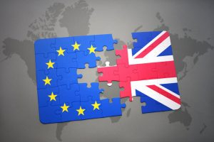 British flag and European Union flag as puzzles pieces, coming apart