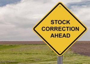 "Yellow road sign against American farmland, reading ""Stock Correction Ahead"""