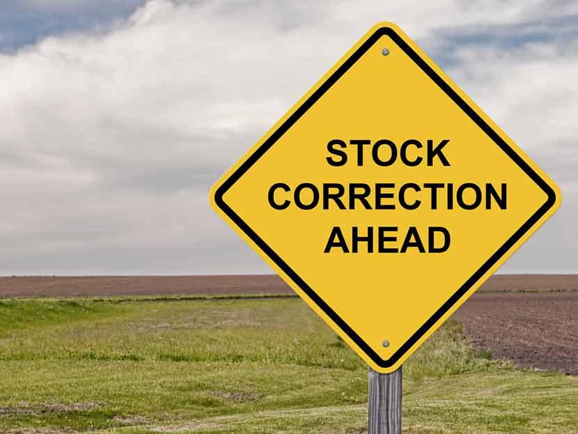 "Yellow road sign against American farmland, reading ""Stock Correction Ahead"""