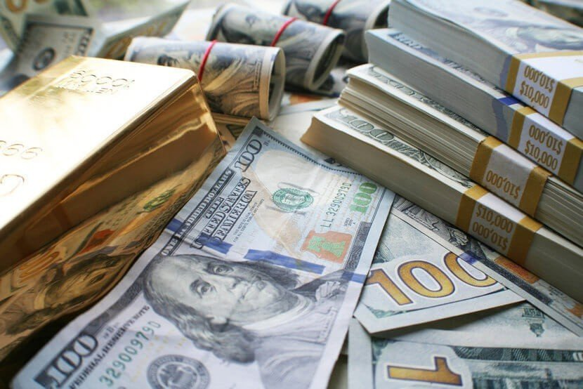 Gold bars and $100 bills, U.S. currency