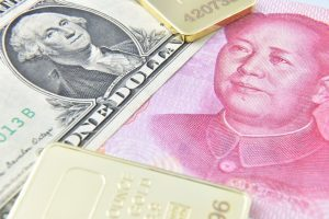 The US dollar, Chinese Yuan, and various gold bars grouped together