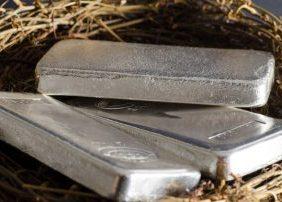 Three shiny silver bars in nest
