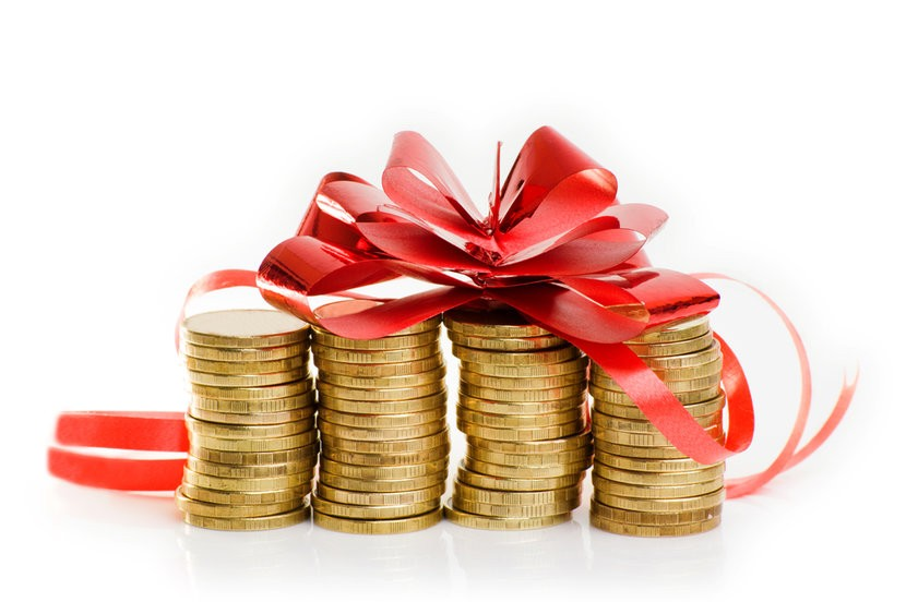 Four stacks of gold coins topped with large red ribbon