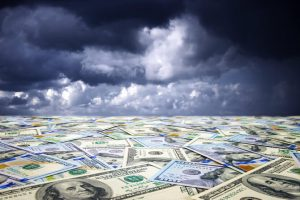 Sea of paper currency under a dark, gloomy sky