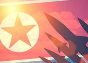 North Korea flag in sky with black missiles shooting into the sky