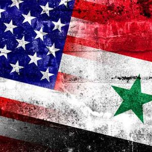 Picture of American and Syrian national flags.