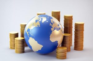 Gold and blue globe surrounded by piles of gold coins