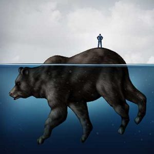 Business man standing on top of a giant bear that is sinking into the ocean