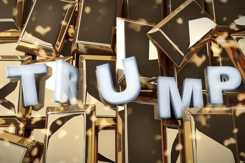 "Silver letters spelling ""Trump"" against background of gold bars"