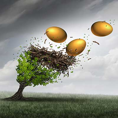 gold eggs in a giant nest being blow out of a tree by strong winds