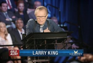 Larry King hosting session about buying gold, featuring industry experts