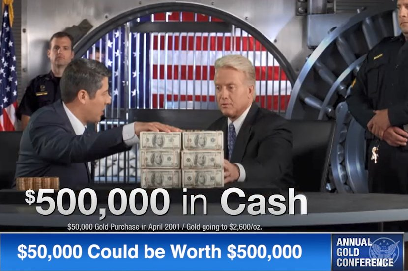$500,000 in cash sitting on table in front of two men and a gold vault in background