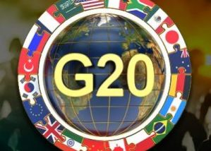 G20 Summit concept with globe surrounded by all of the attending countries flags