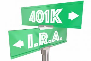 Green 401k and IRA street sign, pointing in two different directions